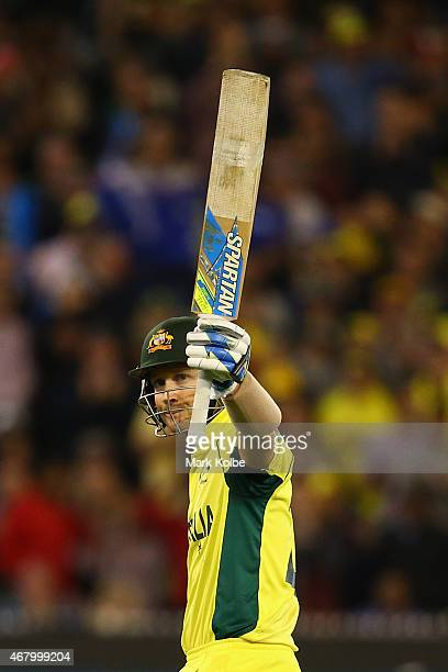Michael Clarke of Australia celebrates after reaching his half century during the 2015 ICC Cricket World Cup final match between Australia and New...