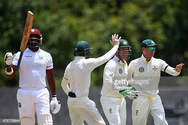 Michael Clarke of Australia celebrates after taking a catch to dismiss Darren Bravo of West Indies off the bowling of Nathan Lyon of Australia during...