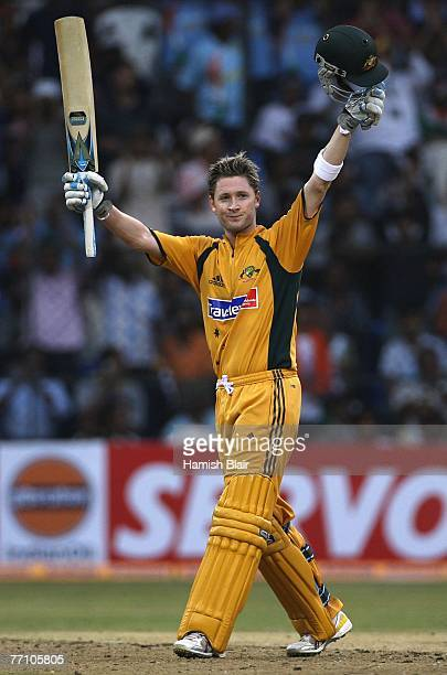 Michael Clarke of Australia celebrates his century during the first One Day International between India and Australia at M Chinnaswamy Stadium on...