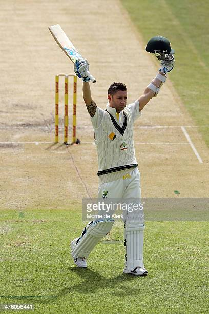 Michael Clarke of Australia celebrates reaching 100 runs during day 2 of the third test match between South Africa and Australia at Sahara Park...
