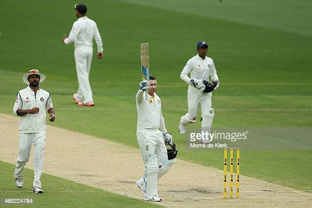 Michael Clarke of Australia celebrates reaching 100 runs during day two of the First Test match between Australia and India at Adelaide Oval on...