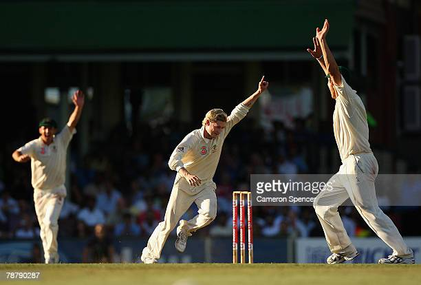 Michael Clarke of Australia celebrates taking the wicket of Ishant Sharma of India during day five to win the Second Test match between Australia and...