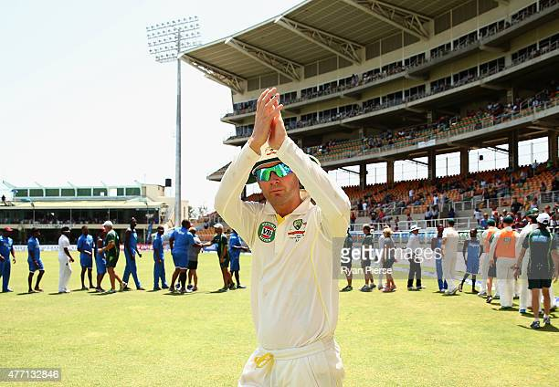 Michael Clarke of Australia celebrates victory after Nathan Lyon of Australia claimed the final wicket to win the test and series during day four of...