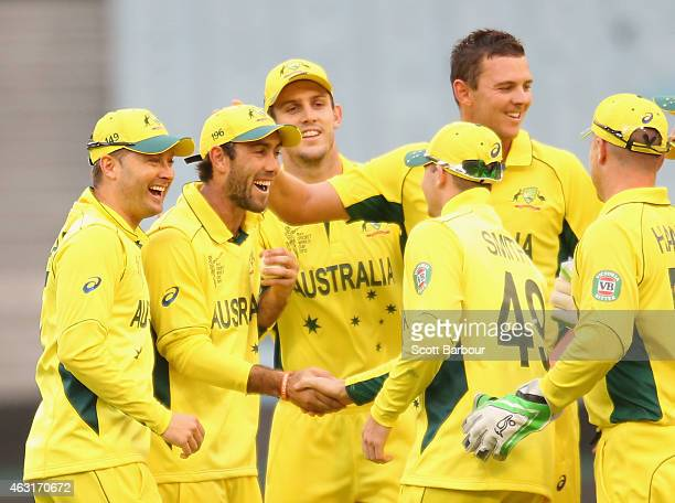 Michael Clarke of Australia congratulates Glenn Maxwell after he took a catch to dismiss Amjad Ali of the United Arab Emirates from the bowling of...