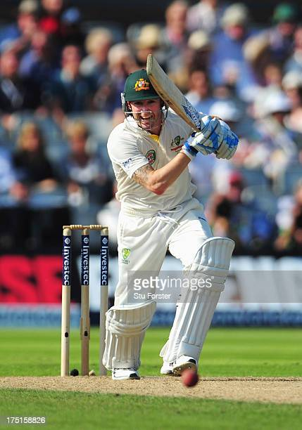 Michael Clarke of Australia drives down the ground during day one of the 3rd Investec Ashes Test match between England and Australia at Old Trafford...