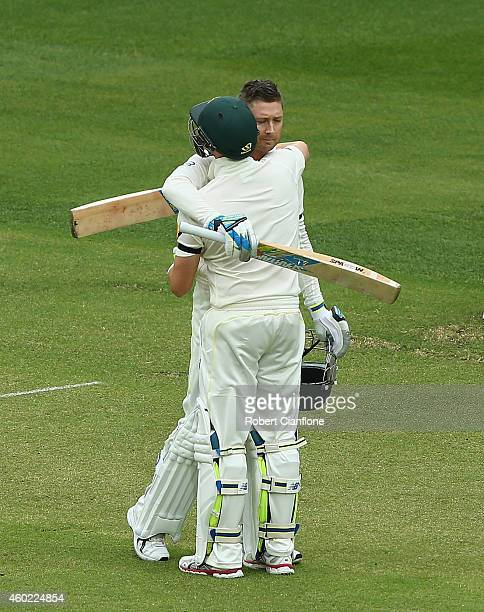 Michael Clarke of Australia embraces teammate Steve Smith after scoring his century during day two of the First Test match between Australia and...