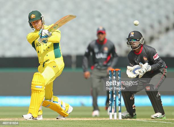 Michael Clarke of Australia hits a boundary as wicketkeeper Swapnil Patil of the United Arab Emirates looks on during the Cricket World Cup warm up...