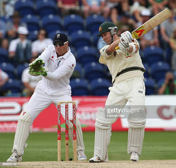 Michael Clarke of Australia hits out watched by Matt Prior of England during day three of the npower 1st Ashes Test Match between England and...