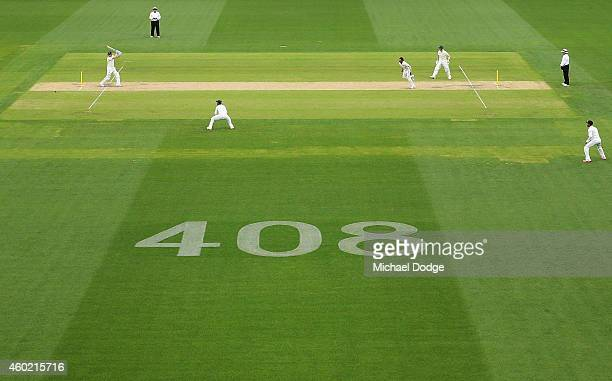Michael Clarke of Australia hits the ball with the number 408 displayed as a tribute to the late Phillip Hughes who was the 408th test player for...