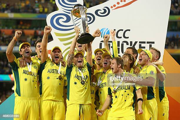 Michael Clarke of Australia holds the trophy aloft as Australian players celebrate winning the 2015 ICC Cricket World Cup final match between...