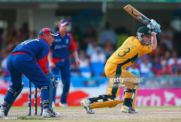 Michael Clarke of Australia in action watched by Paul Nixon of England during the ICC Cricket World Cup Super Eights match between Australia and...