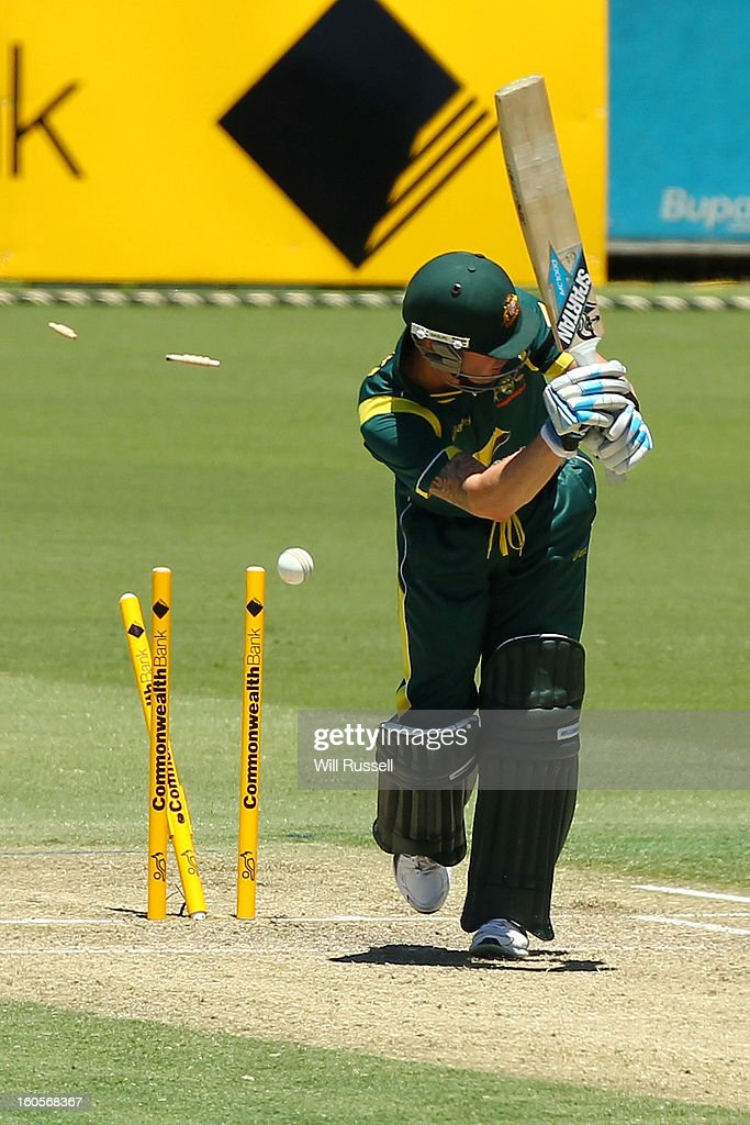 Michael Clarke of Australia is bowled out by Dwayne Bravo of the West Indies during game two of the Commonwealth Bank One Day International Series between Australia and the West Indies at WACA on February 3, 2013 in Perth, Australia.