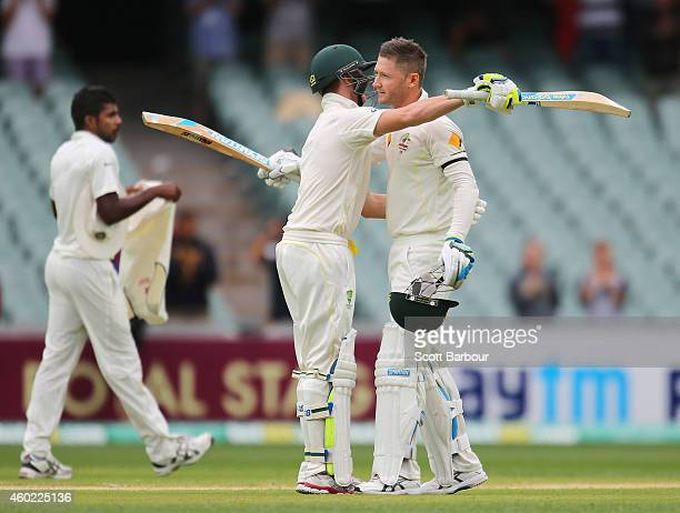 Michael Clarke of Australia is congratulated by Steven Smith as he reaches his century during day two of the First Test match between Australia and...
