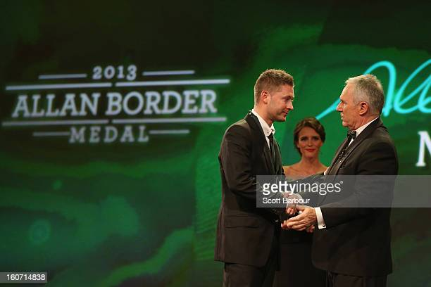 Michael Clarke of Australia is presented with the the Allan Border Medal on stage by Allan Border during the 2013 Allan Border Medal awards ceremony...