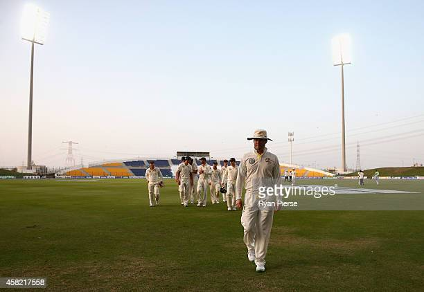 Michael Clarke of Australia leads his team from the field as bad light stopped play during Day Three of the Second Test between Pakistan and...