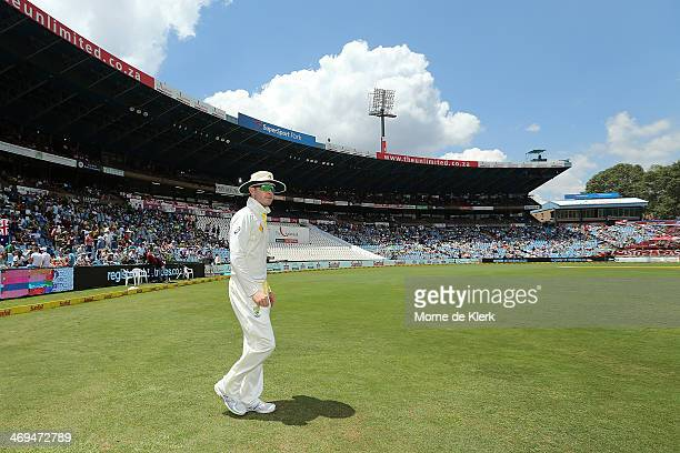 Michael Clarke of Australia leads his team onto the field after lunch during day four of the First Test match between South Africa and Australia on...