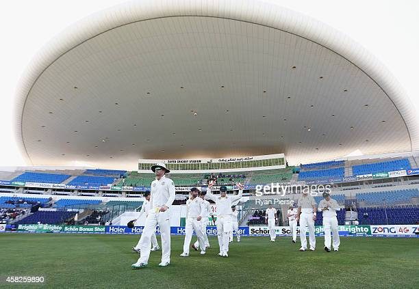 Michael Clarke of Australia leads his team onto the field during Day Four of the Second Test between Pakistan and Australia at Sheikh Zayed Stadium...
