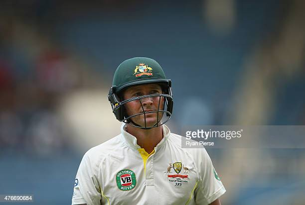 Michael Clarke of Australia leaves the ground after being caught and bowled by Kemar Roach of West Indies before the delivery was judged a no ball...