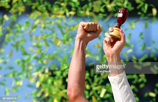 Michael Clarke of Australia lifts the urn during day three of the Fifth Ashes Test match between Australia and England at Sydney Cricket Ground on...