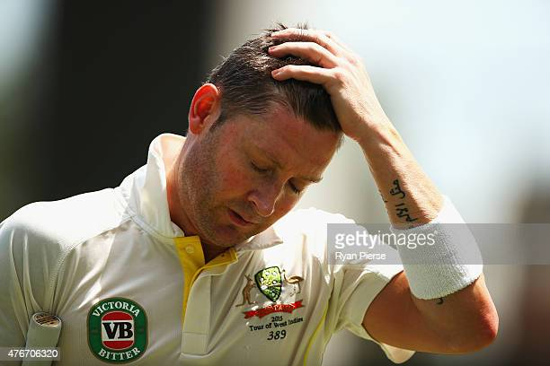 Michael Clarke of Australia looks dejected after being dismissed by Jason Holder of West Indies during day one of the Second Test match between...