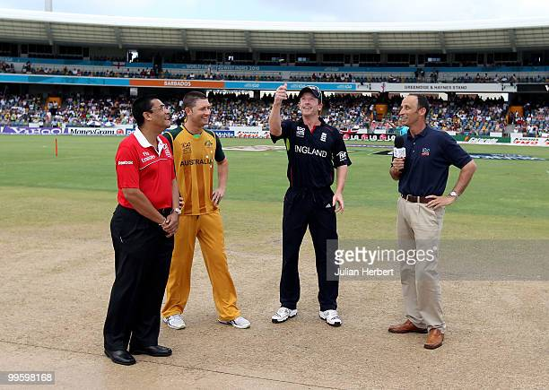 Michael Clarke of Australia looks on as Paul Collingwood tosses the coin before the final of the ICC World Twenty20 between Australia and England...