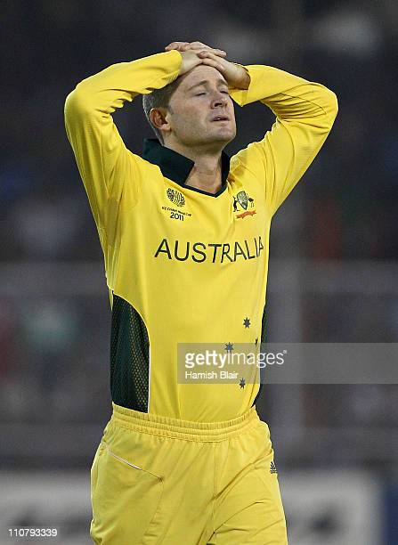 Michael Clarke of Australia looks on during the 2011 ICC World Cup Quarter Final match between Australia and India at Sardar Patel Stadium on March...