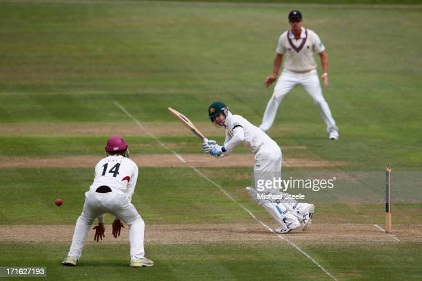 Michael Clarke of Australia plays to the legside past Christopher Jones of Somerset during day two of the Somerset versus Australia tour match at The...