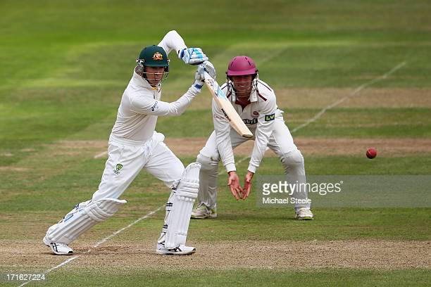 Michael Clarke of Australia plays to the offside as Christopher Jones of Somerset looks on during day two of the Somerset versus Australia tour match...