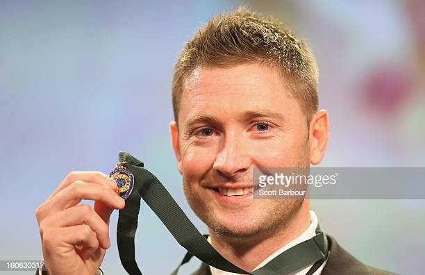 Michael Clarke of Australia poses after winning the Allan Border Medal during the 2013 Allan Border Medal awards ceremony at Crown Palladium on...