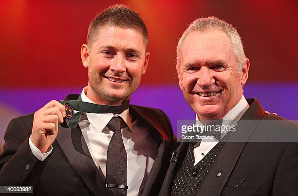 Michael Clarke of Australia poses with Allan Border after winning the Allan Border Medal during the 2012 Allan Border Medal Awards at Crown Palladium...
