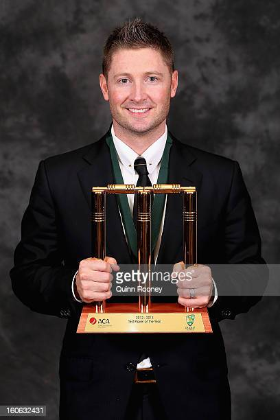 Michael Clarke of Australia poses with his trophy after being named the Test Player of the Year at the 2013 Allan Border Medal awards ceremony at...