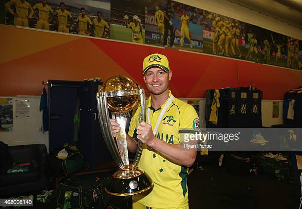 Michael Clarke of Australia poses with the trophy in the change rooms after the 2015 ICC Cricket World Cup final match between Australia and New...