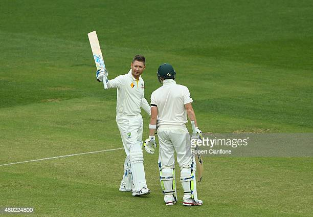 Michael Clarke of Australia raises his bat after scoring his century during day two of the First Test match between Australia and India at Adelaide...