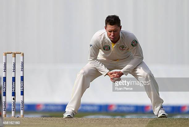 Michael Clarke of Australia reacts while bowling during Day Two of the Second Test between Pakistan and Australia at Sheikh Zayed Stadium at Sheikh...