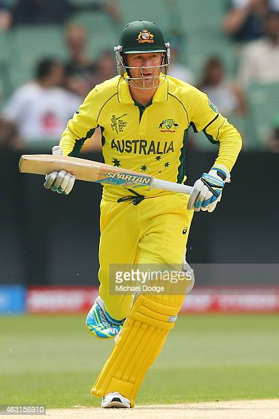 Michael Clarke of Australia runs after a shot during the Cricket World Cup warm up match between Australia and the United Arab Emirates at Melbourne...