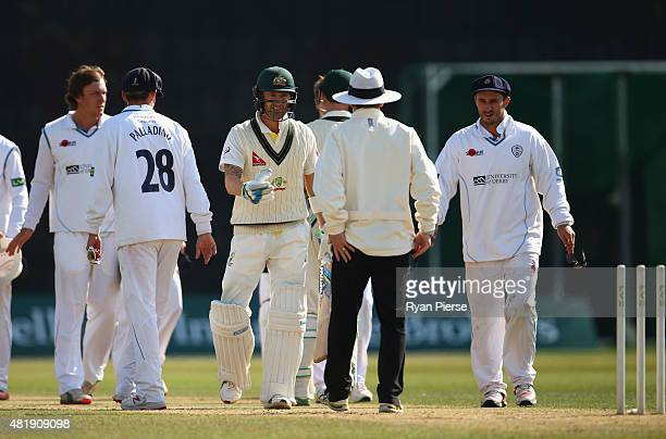 Michael Clarke of Australia shakes hands with the umpire as the match is drawn during day three of the Tour Match between Derbyshire and Australia at...