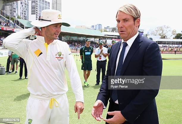 Michael Clarke of Australia speaks to Shane Warne during day five of the Third Ashes Test match between Australia and England at The WACA on December...