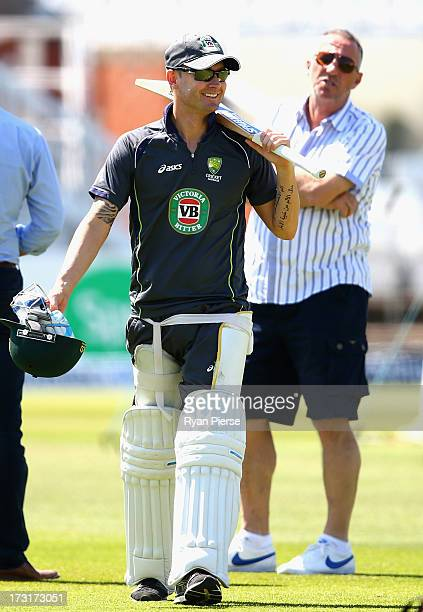 Michael Clarke of Australia speaks with Sir Ian Botham during an Australian Nets Session at Trent Bridge on July 9 2013 in Nottingham England
