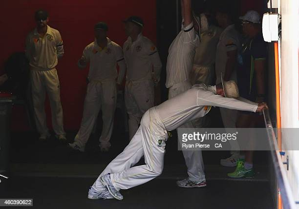 Michael Clarke of Australia stretches before taking to the field after the lunch break during day five of the First Test match between Australia and...