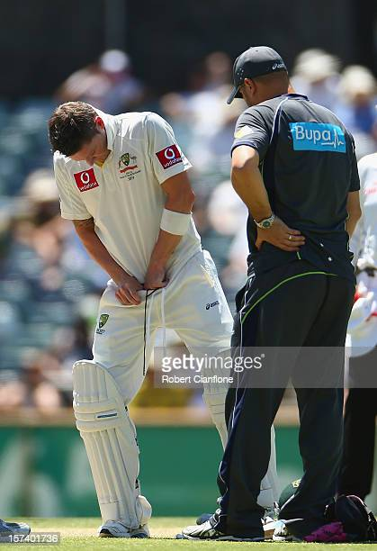Michael Clarke of Australia takes a break after he was hit by delivery in the groin during day four of the Third Test Match between Australia and...