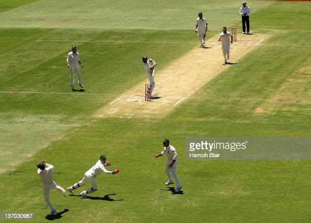 Michael Clarke of Australia takes a catch to dismiss Zaheer Khan of India from the bowling of Ben Hilfenhaus of Australia during day three of the...
