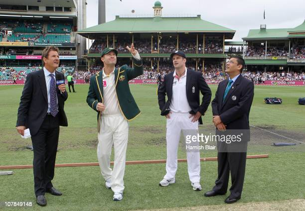 Michael Clarke of Australia tosses the coin with Andrew Strauss of England looking on ahead of day one of the Fifth Ashes Test match between...