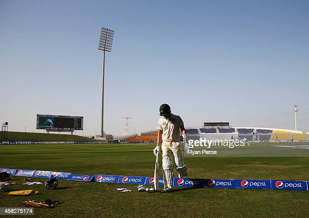 Michael Clarke of Australia walks from the ground after being dismissed by Zulfiqar Babar of Pakistan during Day Four of the Second Test between...