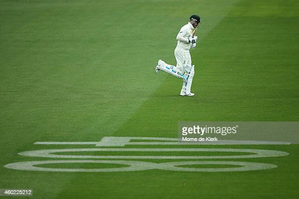 Michael Clarke of Australia walks out to bat past the number 408 that was painted on the ground as a tribute to former cricketer Phillip Hughes...