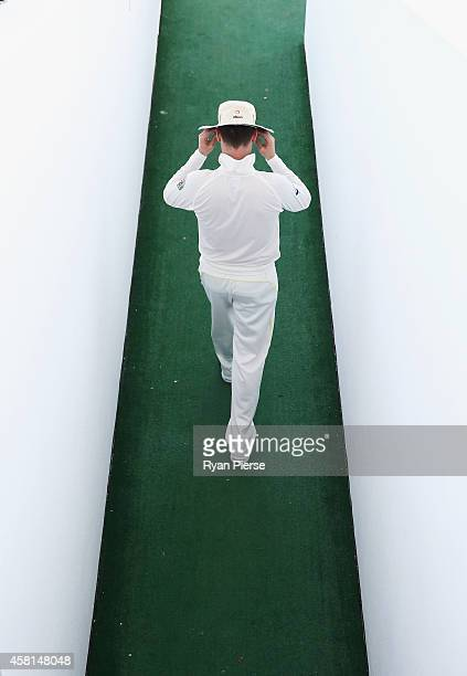 Michael Clarke of Australia walks out to take the field during Day Two of the Second Test between Pakistan and Australia at Sheikh Zayed Stadium at...