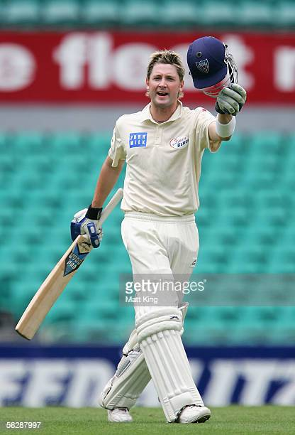Michael Clarke of the Blues celebrates scoring a double century during day four of the Pura Cup match between the NSW Blues and the Queensland Bulls...