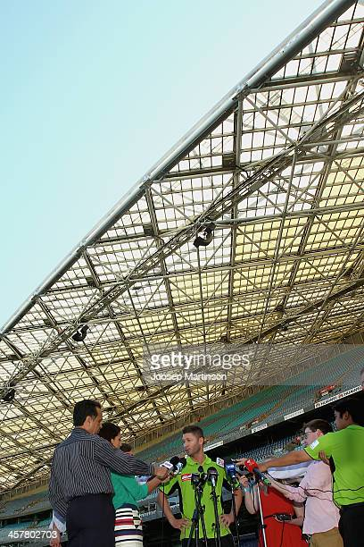 Michael Clarke speaks to media during a Sydney Thunder Big Bash League media session at ANZ Stadium on December 19 2013 in Sydney Australia
