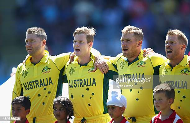 Michael Clarke Steve Smith Aaron Finch and David Warner of Australia sing the national anthem during the 2015 ICC Cricket World Cup match between...