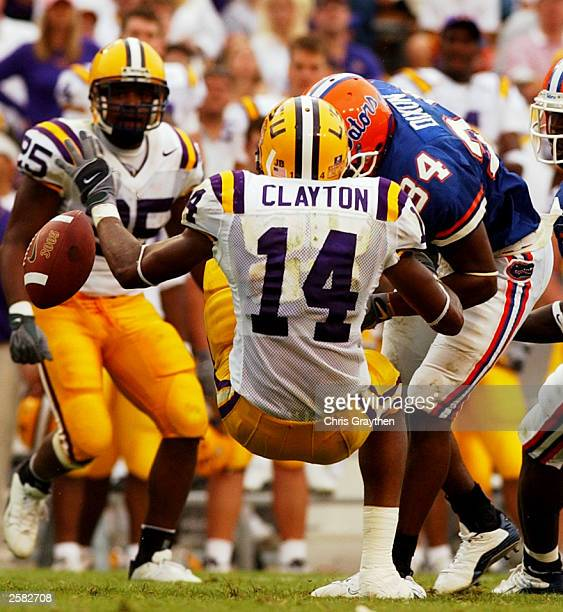 Michael Clayton of the Louisiana State University Tigers is hit hard by Daryl Dixon for an incomplete pass on October 11 2003 at Tiger Stadium in...