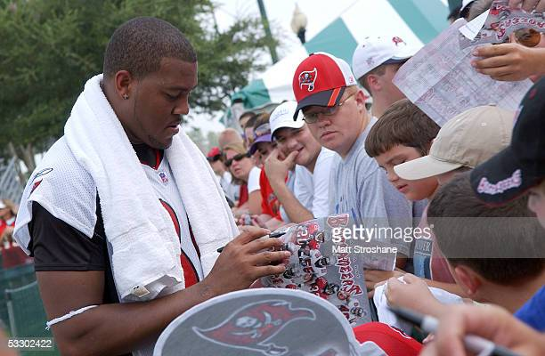 Michael Clayton of the Tampa Bay Buccaneers signs autographs after the morning work outs during training camp at Disney's Wide World of Sports...
